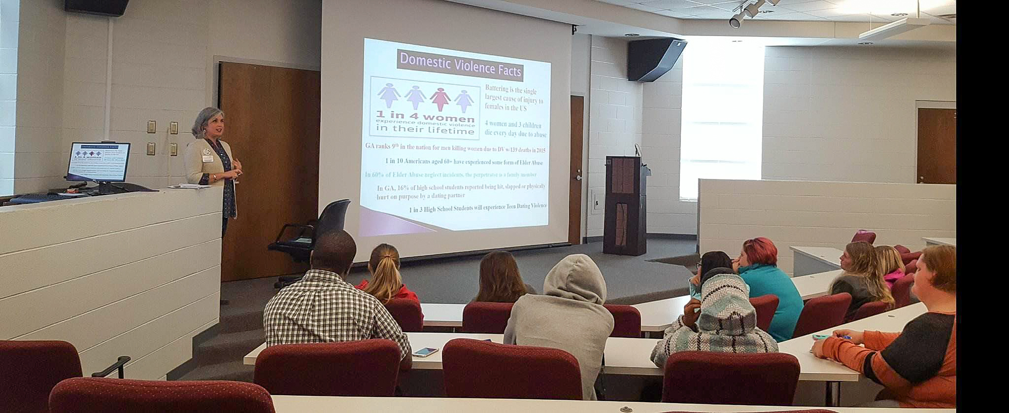 Family Crisis Center (FCC) staffer Becky Daniel speaks with several dozen Georgia Northwestern Technical College students, faculty, and staff Wednesday about what the FCC has to offer. This was part of GNTC's push to recognize Domestic Violence Awareness month this October.