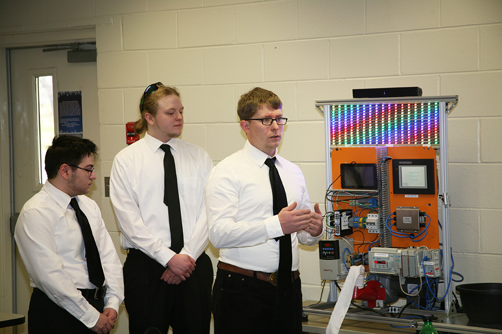 Beck Maxwell (left), Jake Woodall (center), and Derek Walck (right) presented a PLC-based candy machine they constructed for the Engineering Technology/Design SkillsUSA Georgia competition. All three students are pursuing degrees in GNTC's Instrumentation and Controls program. Maxwell was part of a SkillsUSA team last year that won the gold medal in the SkillsUSA statewide competition and the bronze medal in the SkillsUSA national competition.