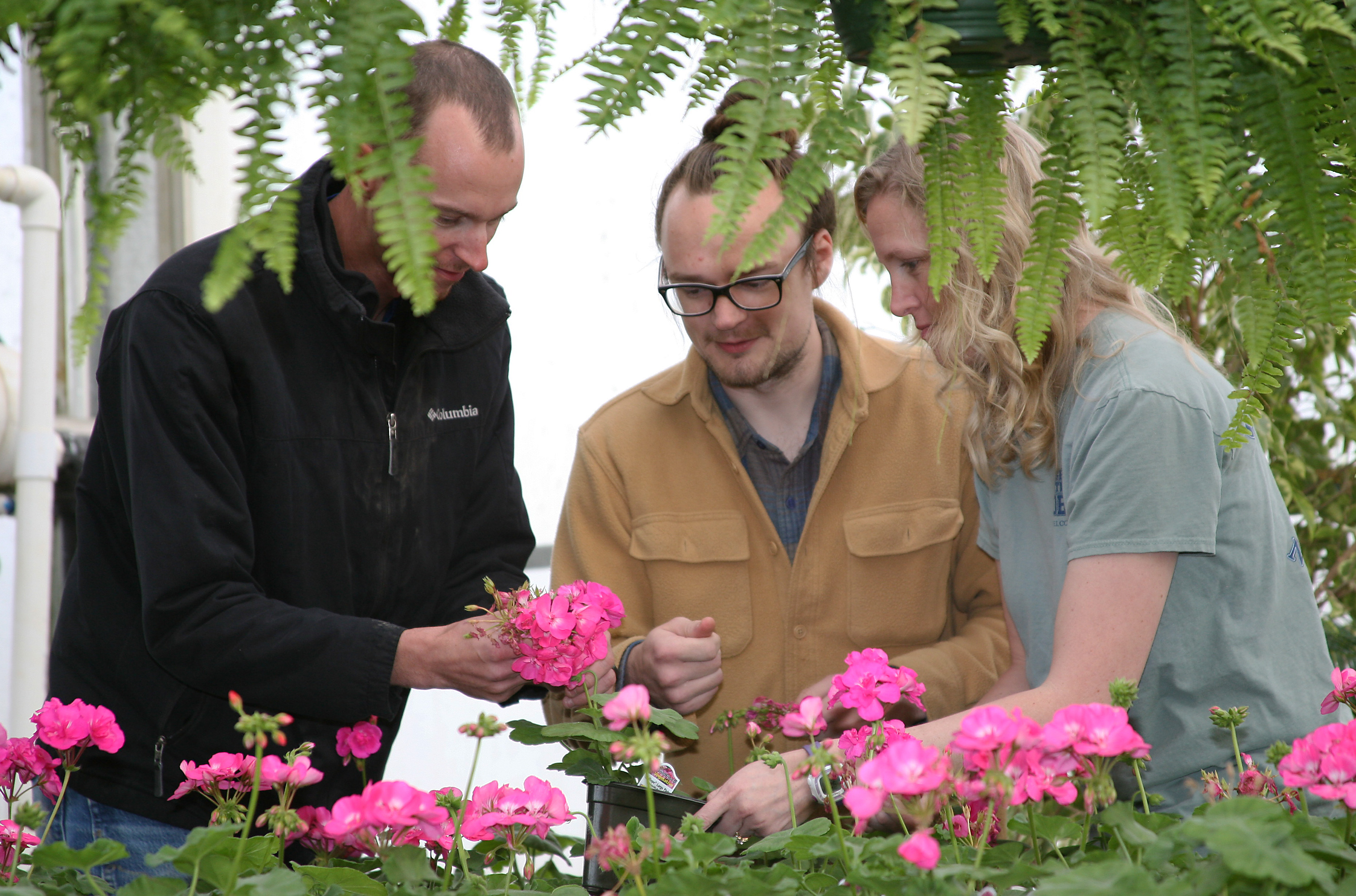 Chase Bohannon (left) of Calhoun, Jeffrey King (center) of Rome, and Jessica Wakefield (right) of Rome prepare for GNTC's Spring Plant Sale.