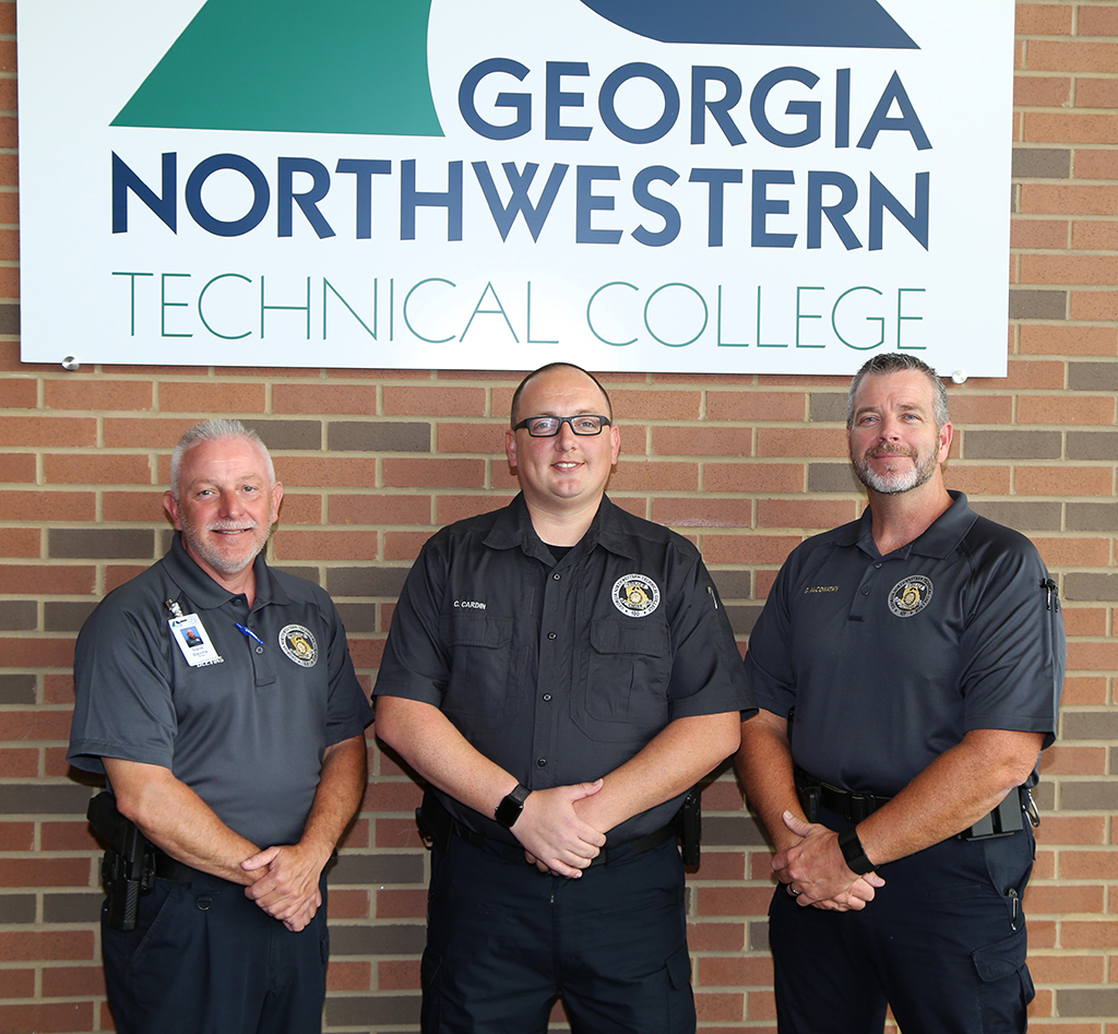 Chad Cardin (center) chief of police at GNTC, poses for a picture during a regional police chief meeting held on the Gordon County Campus in Calhoun. Also pictured is Steve Blevins (left), police officer at GNTC's Walker County Campus, and Gary McConathy (right), police lieutenant at GNTC's Gordon County Campus.
