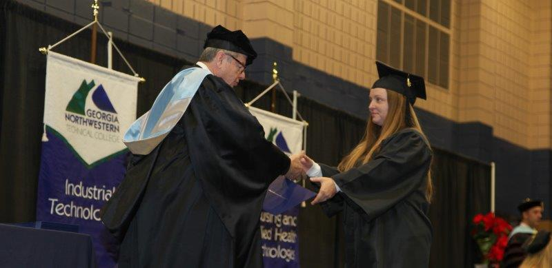Walker County, Georgia native Haleigh Condra receives her award in Early Childhood Care and Education from Georgia Northwestern Technical College President Pete McDonald.