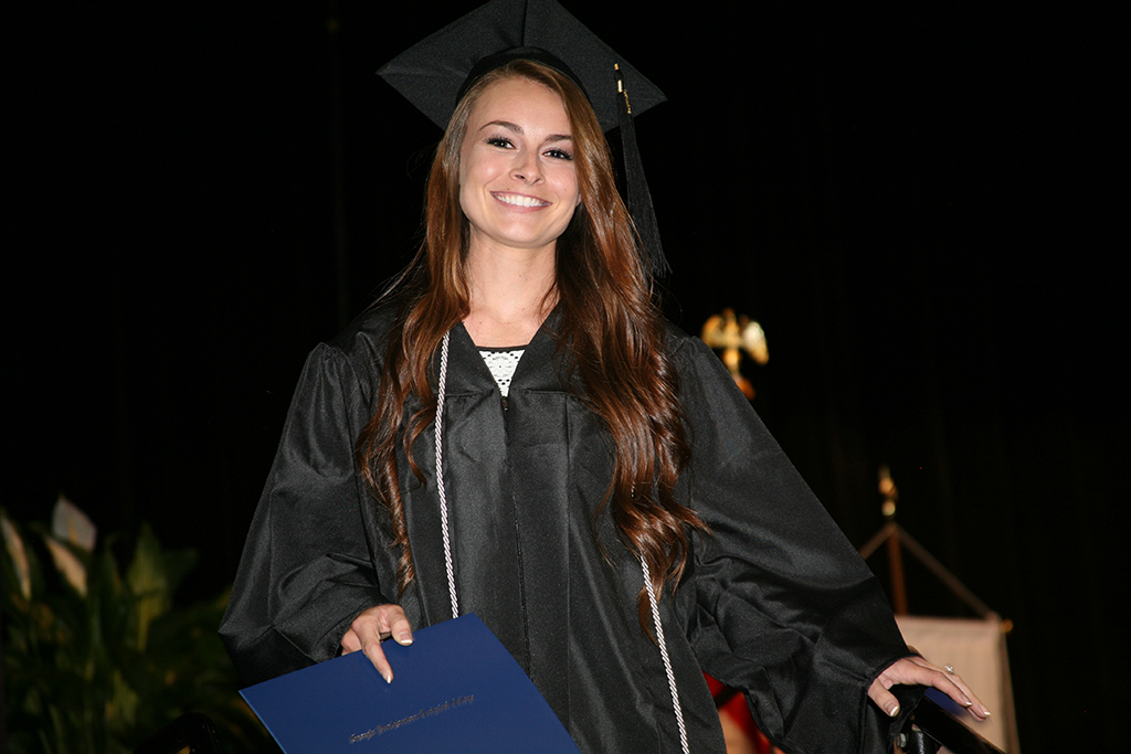 Jessica Holcomb celebrates after getting her associate degree in Nursing.