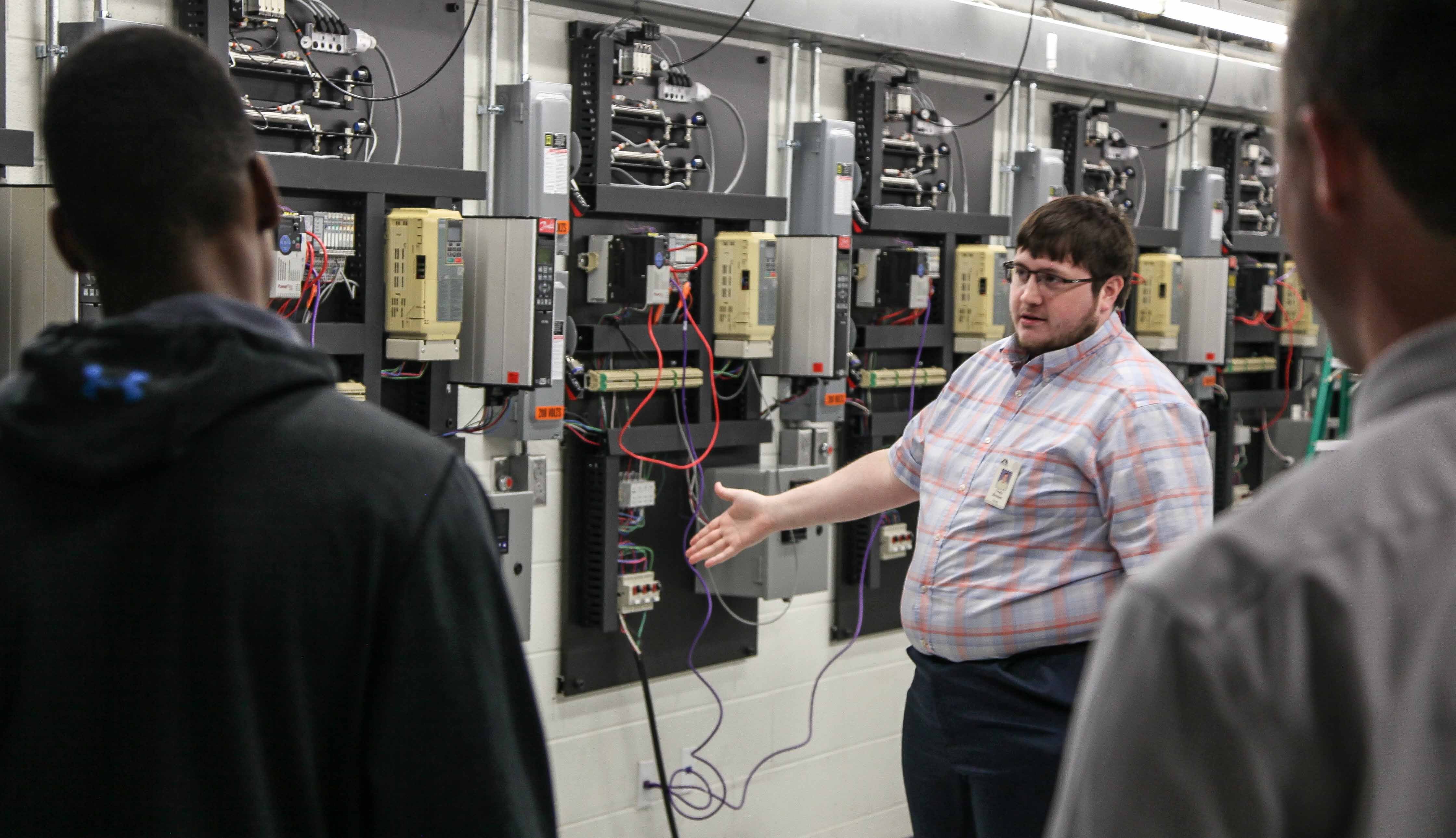 Georgia Northwestern Technical College Electronics Technology Instructor Cody Brewer speaks with students from Ringgold High Schools' Career Exploration program touring GNTC's Catoosa County Campus in Ringgold, Georgia.