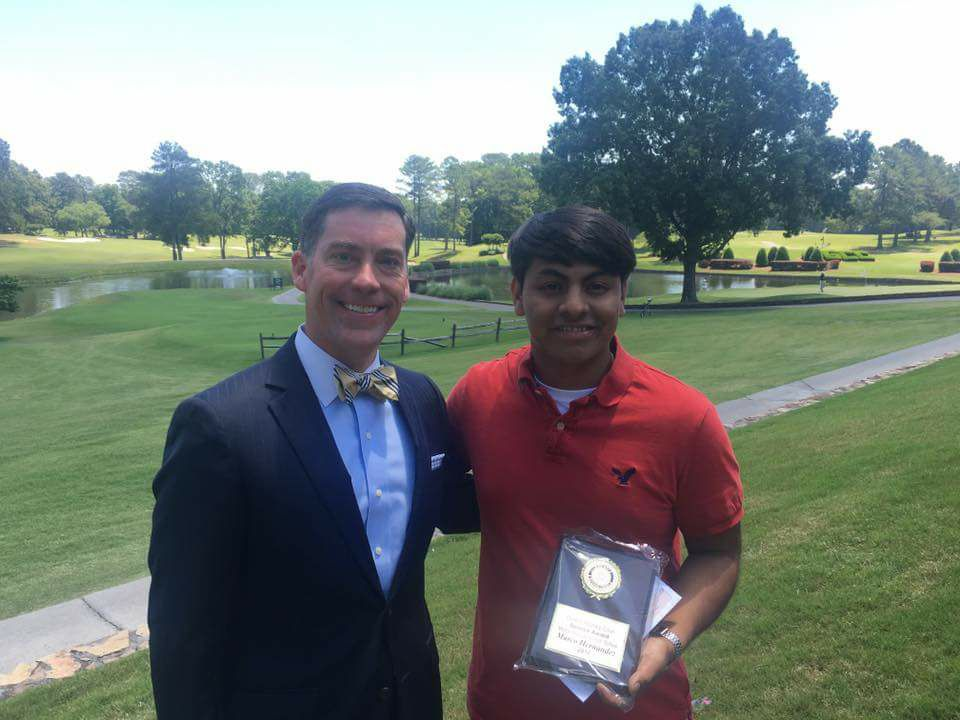 "Dalton Rotary Club member Rob Bradham presented Morris Innovative High School senior Marco Hernandez with the Dalton Rotary Club ""Service Above All"" Award earlier this month. Hernandez plans to attend Georgia Northwestern Technical College this fall."