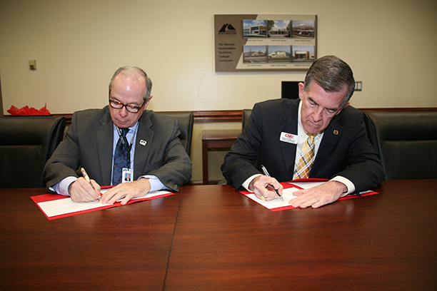 Pete McDonald (left), president of GNTC, and Dr. Mike Holmes (right), senior vice president, chief academic officer, and dean of faculty at GMC sign an articulation agreement at GNTC's Floyd County Campus in Rome.
