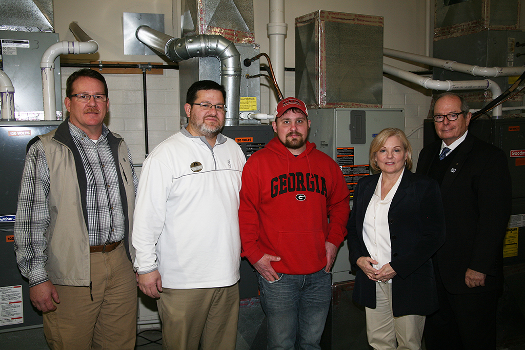 (From left to right) Barry Williams, dean of Academic Affairs at GNTC; Chad Wheat, director of the Air Conditioning Technology program at GNTC, Chris Roberson, Phoenix Patriot Foundation's Veteran Scholarship recipient; Michelle Beatson, administrative liaison to Institutional Advancement at GNTC; and Pete McDonald, president of GNTC, pose for a picture in the Air Conditioning Technology lab on the Floyd County Campus in Rome.