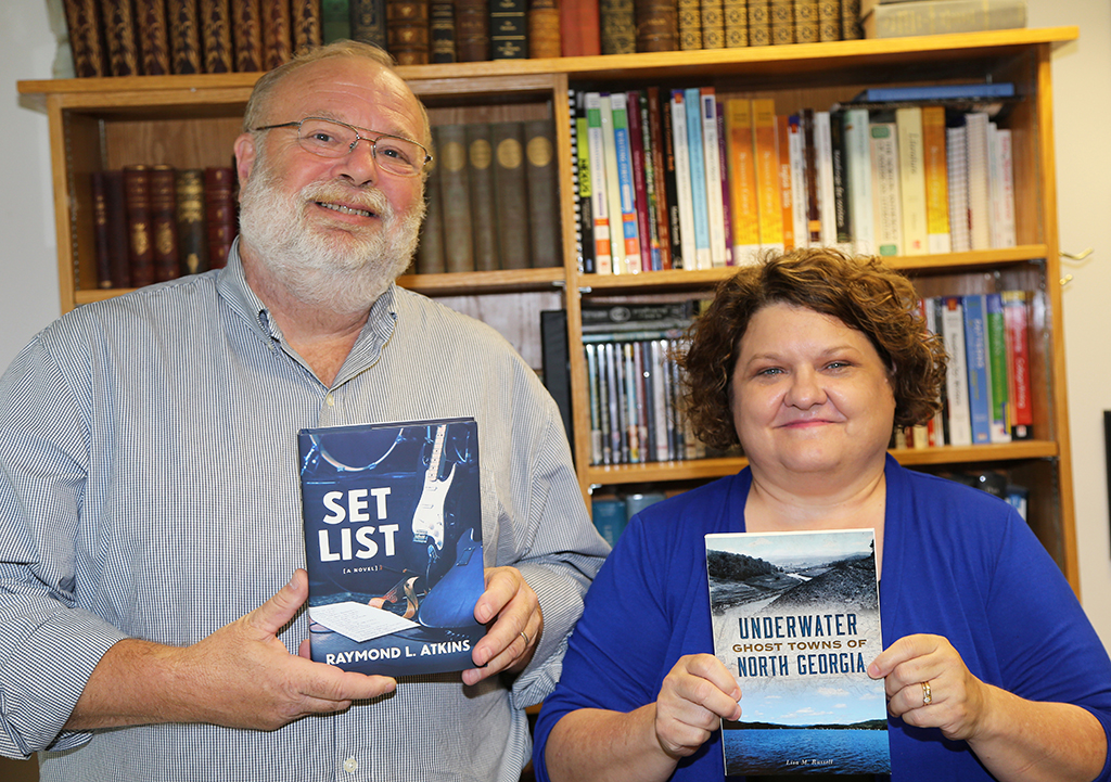 "Raymond L. Atkins (left) recently released the new novel ""Set List"" and author and historian Lisa M. Russell (right) recently released her new book ""Underwater Ghost Towns of North Georgia."" Atkins and Russell are instructors of English at GNTC."