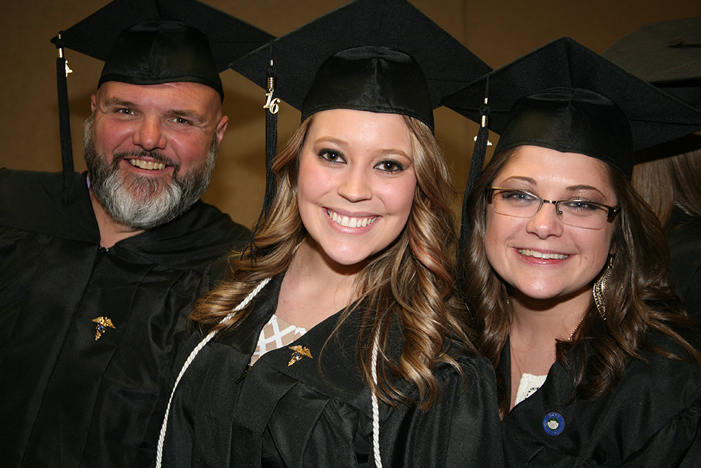 Ron Satterwhite (left), Lauren Sherwood (center), and Peggy Shiflett (right) line up before Processional during last year's Spring Commencement Ceremony in 2016.