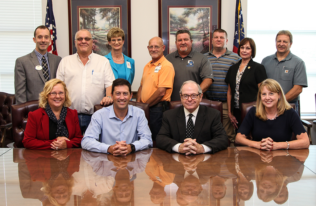 Shown in the front row, from left, are Rhonda Beasley, Roper Corporation Human Resources Manager; Scott Brown, Roper Corporation President; C. Pete McDonald, GNTC President; Dr. Heidi Popham, GNTC Executive Vice President.