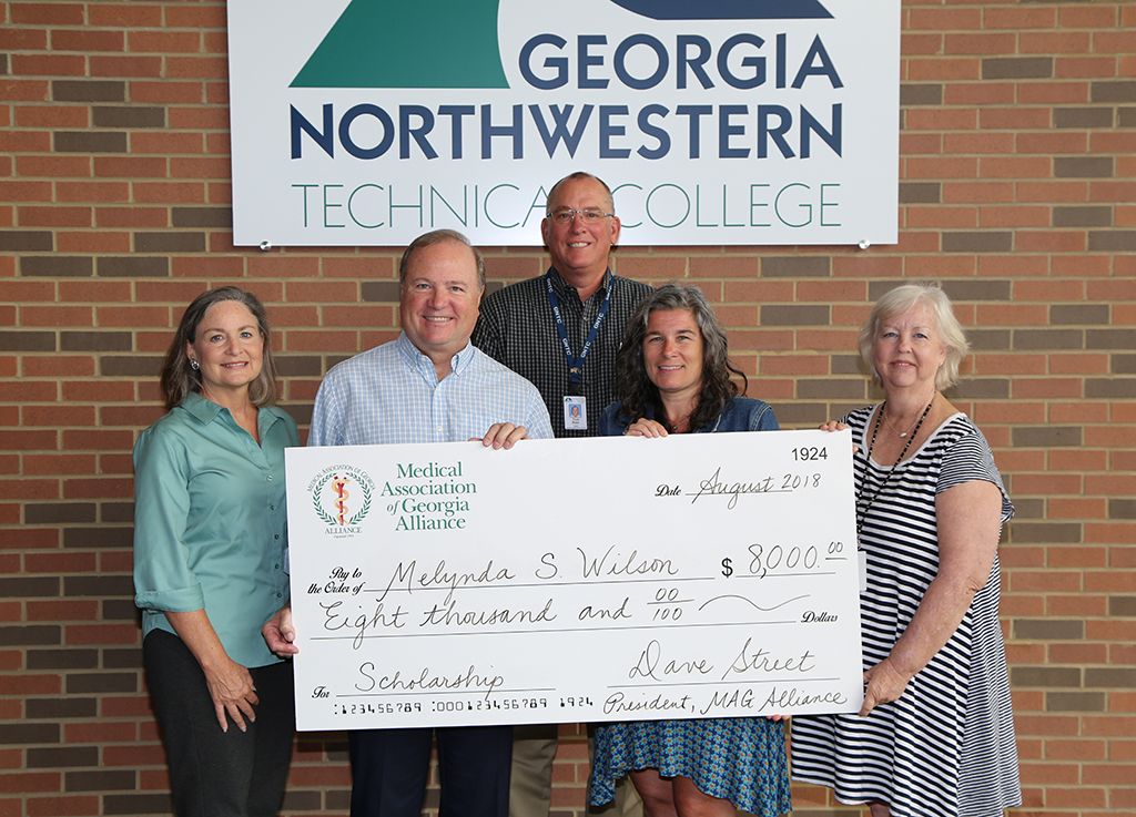 The Medical Association of Georgia (MAG) Alliance presented a GNTC student with an $8,000 scholarship at the Gordon County Campus. (From left to right) Merrilee Gober, MAG Alliance member; Dave Street, president of the MAG Alliance; Tom Bojo, dean of Public Service Technology at GNTC; Melynda Wilson, scholarship recipient; and Kathy Kerce, director of the Lactation Consultant program at GNTC.