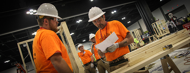 Georgia Northwestern Technical College's 2016 SkillsUSA TeamWorks members Bo Dooley, left, returns for a chance to take home the national title in 2017. Also shown in this picture from the 2016 state competition in Atlanta, Georgia is 2016 team member Burt Burns. In the background, from left, is Tanner Boyd and Barry Arrington. Arrington will also be returning for the 2017 competitions