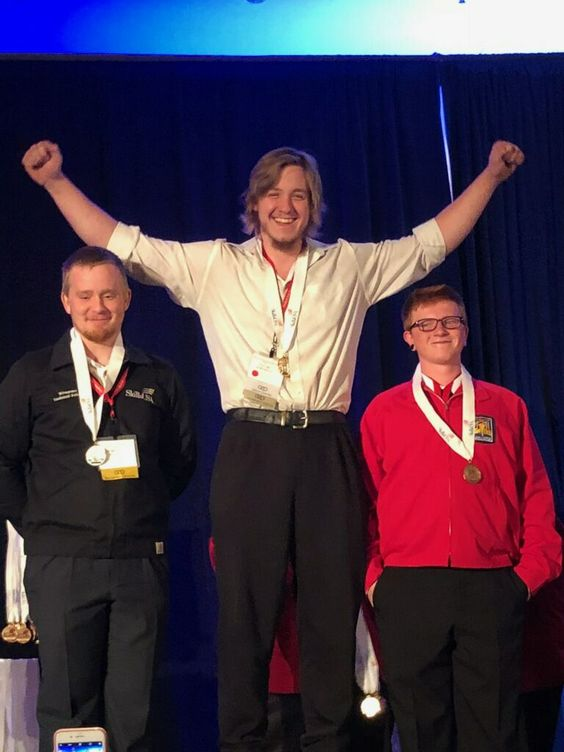 GNTC Welding student Jacob Hargrove, center, stretches out his arms in victory after being named the gold medal winner in this past week's SkillsUSA Georgia Welding competition. The Catoosa County, Georgia resident is one of 17 GNTC students who have qualified to compete against the best in the country at their professions at the National SkillsUSA Competition in Louisville, Kentucky this June.