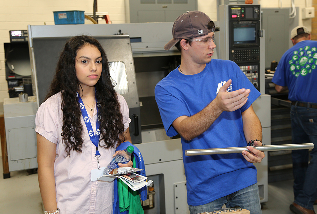 Alison Castro (left) of Armuchee High School watches a demonstration being led by Steven Price (right), a Precision Machining and Manufacturing student at GNTC.