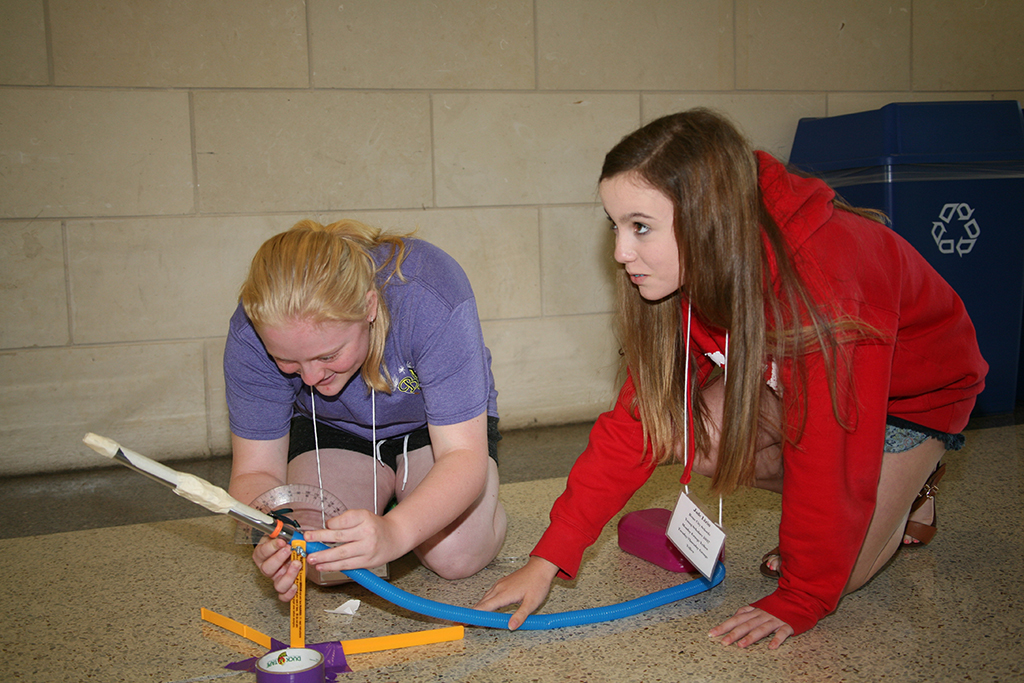 Emily Self (left) and Jade Lizin (right) of Rome Middle School prepare to launch a rocket as part of a project for an Aerospace Engineering class during the Young Scholars Program at GNTC, June 12-15.