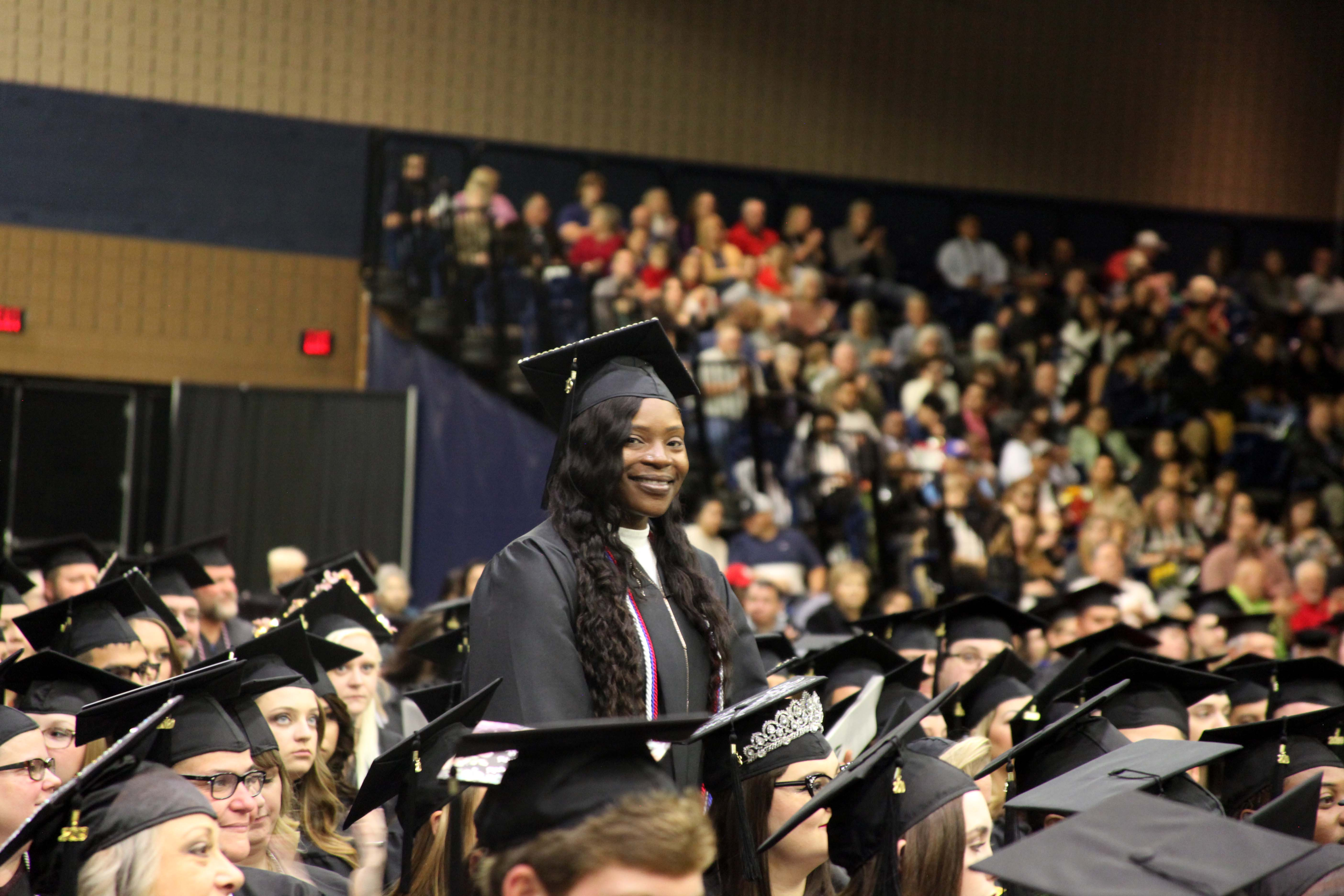GNTC Student Government Association (SGA) President Jaweah Hamilton stands during the Fall 2019 Commencement Ceremony at the Dalton Convention Center. Hamilton was being recognized for her service in SGA and received an Associate of Applied Science Degree in Early Childhood Care and Education.