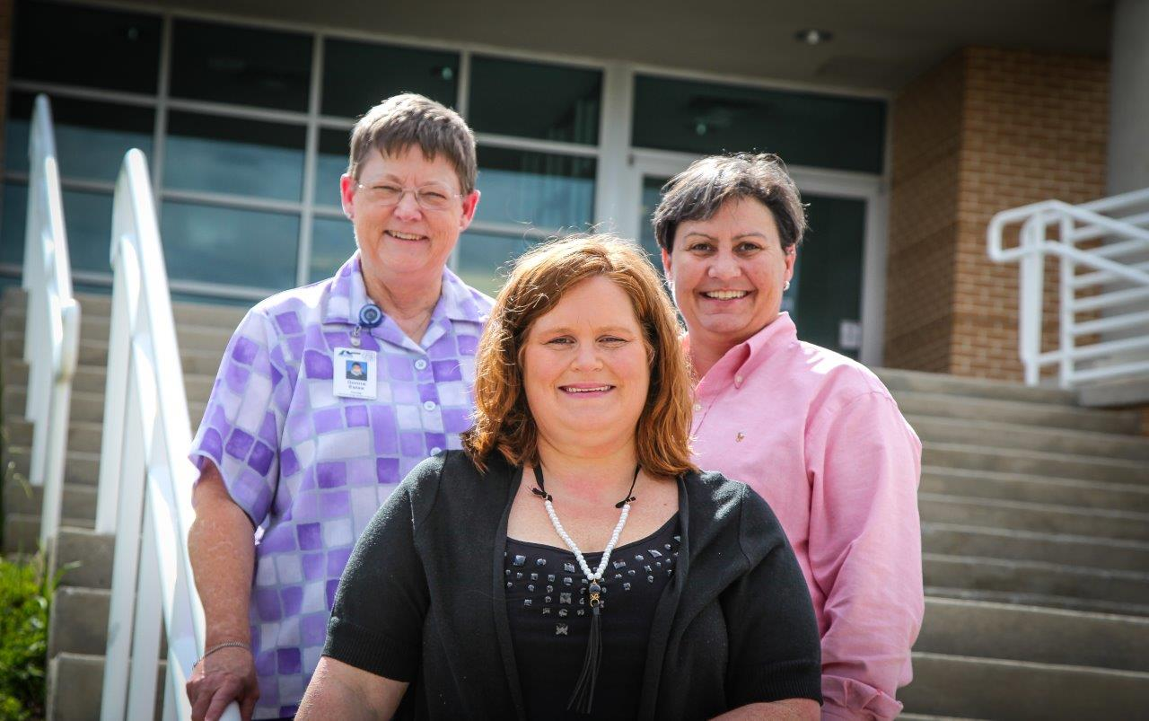 Georgia Northwestern Technical College Health Information Management Technology instructors Donna Estes, left, and Susan Bowman, right, pose with one of their latest success stories in Ringgold, Georgia's Katrina Putman.