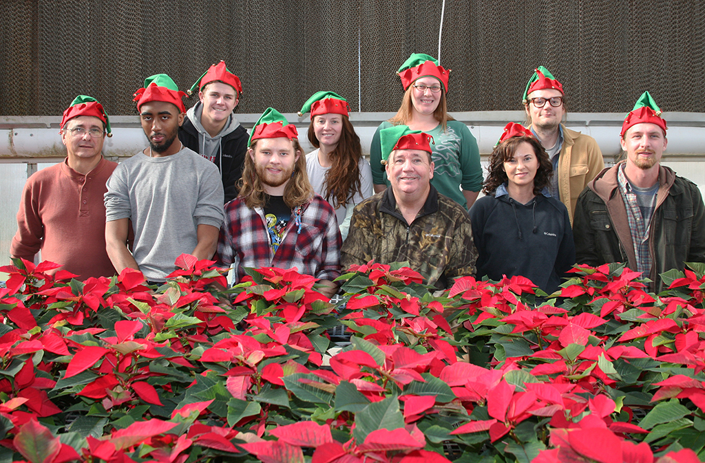 Horticulture students pose in front of the poinsettias that are on sale for $4 each at GNTC's Floyd County Campus. Front row (from left to right) Nick Barton, Deshaun Rozier, Morgan Lathem, Mark King, Terra Coontz, and John Tarvin. Back Row (from left to right) Lane Strickland, Rachel Barden, Shannon Bryant, and Jeffery King.