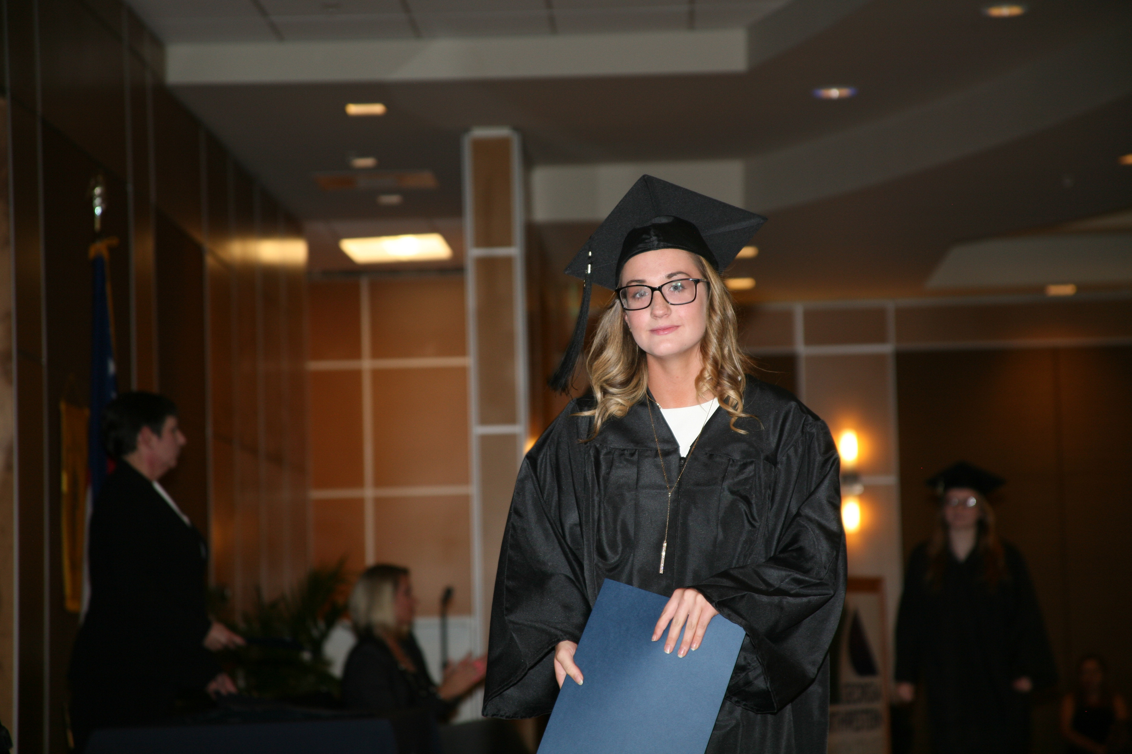 Katy Dodd crosses the stage during GNTC's Spring 2017 GED® Commencement Ceremony.