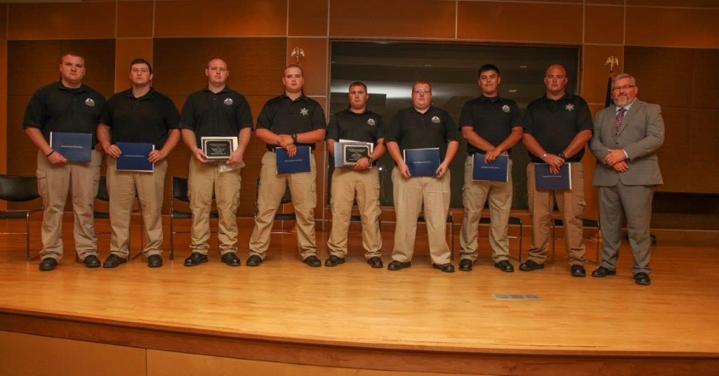 The graduating class of the July 2018 Basic Law Enforcement Academy at Georgia Northwestern Technical College. Shown, from left, are Mason Woodard, Matthew Wilson, Justin Watson, Isreal Smith, Joshua Morse, Jonathan Martin, Hunter Densmore, Dustin Bruce, and Georgia Northwestern Technical College Law Enforcement Academy Director Jim Pledger.