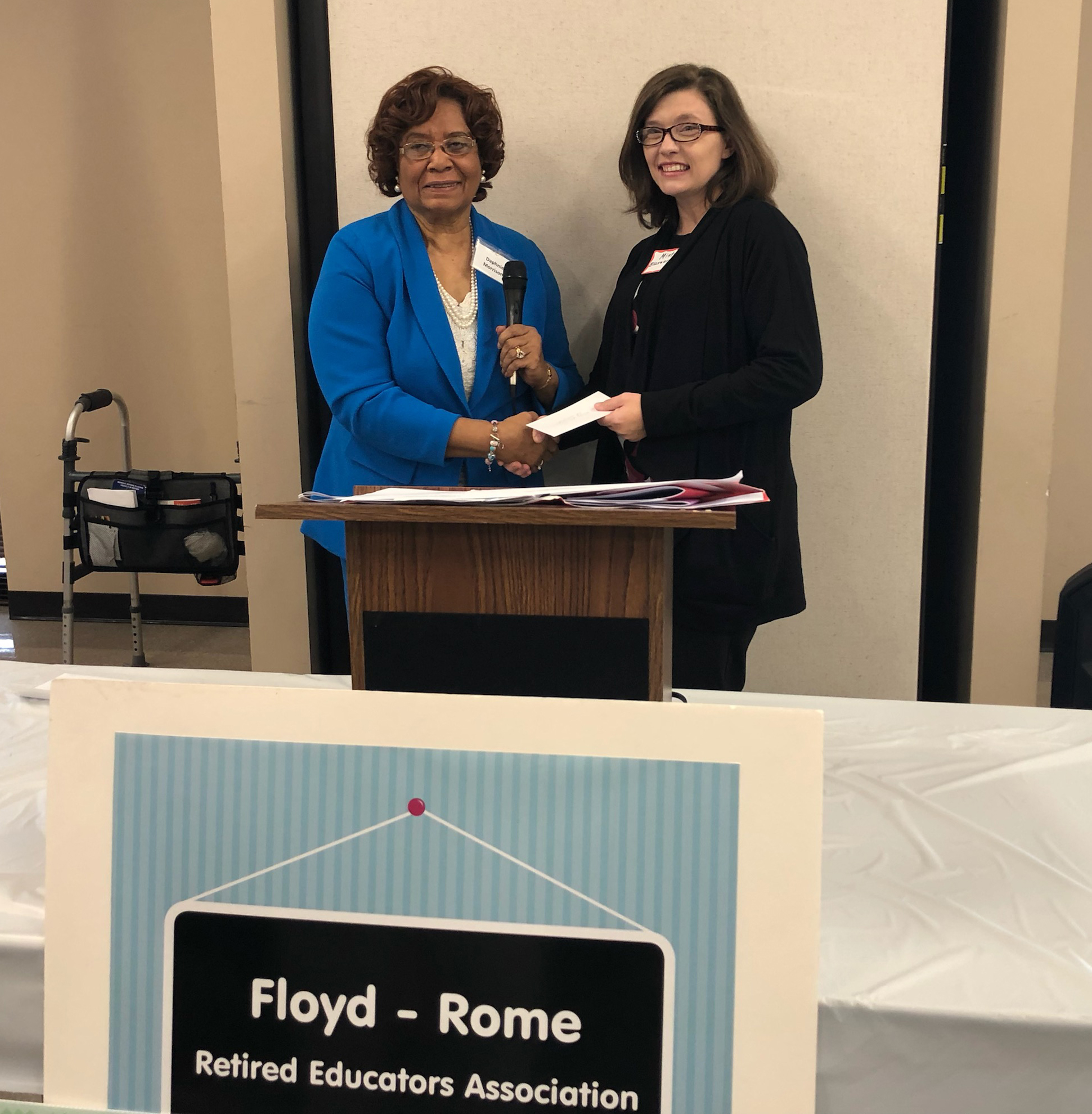 GNTC Early Childhood Care and Education student Misty Blasengame (right) receives a $1,000 scholarship from Daphnie Morrison (left) during a luncheon for the Floyd-Rome Retired Educators Association.