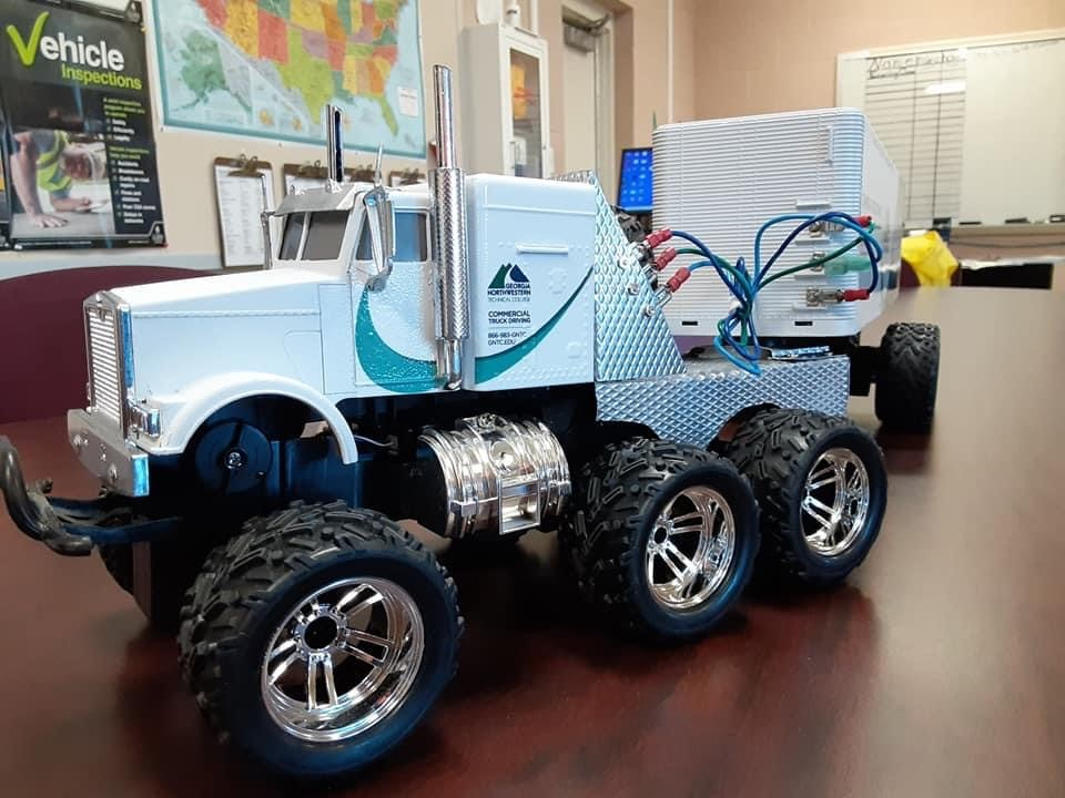 This four-wheel drive RC tractor-trailer was restored by 15-year-old Elijah Knox, son of GNTC graduate Joshua Knox. The truck back was wrapped to look like one of the tractor-trailers driven by students in GNTC's Commercial Truck Driving program.