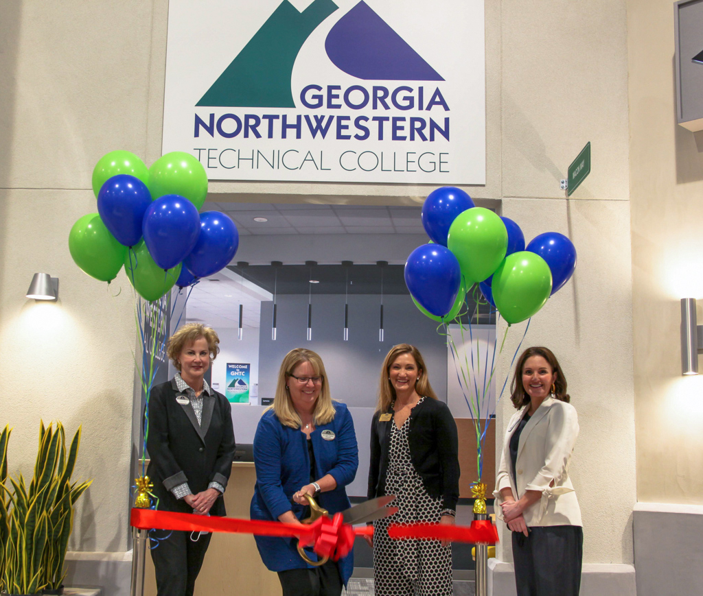 On March 24, 2021, Georgia Northwestern Technical College held a ribbon cutting ceremony to display the college's new storefront housed inside the Junior Achievement (JA) Discovery Center of Greater Dalton. From left to right: Sherrie Patterson, chair of GNTC Foundation Board of Trustees, GNTC President Dr. Heidi Popham, Dr. Michele Taylor, chair of GNTC's Board of Directors and Anna Adamson, Junior Achievement of Georgia director of development for northwest Georgia.