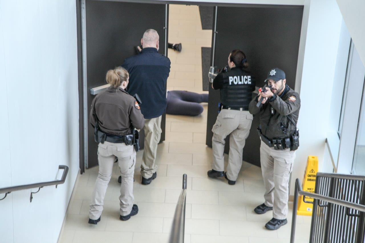 A team of first responders methodically move through the Catoosa County Campus during an Active Shooter Drill on November 30. From left, Deputy LeeAnn Moody, Catoosa County Sheriff's Department; Deputy Doug Licklider, Catoosa County Sheriff's Department; Detective Jennifer Jones, Ringgold Police Department (GNTC Police); and Nigel Torres, Catoosa County Sheriff's Department.