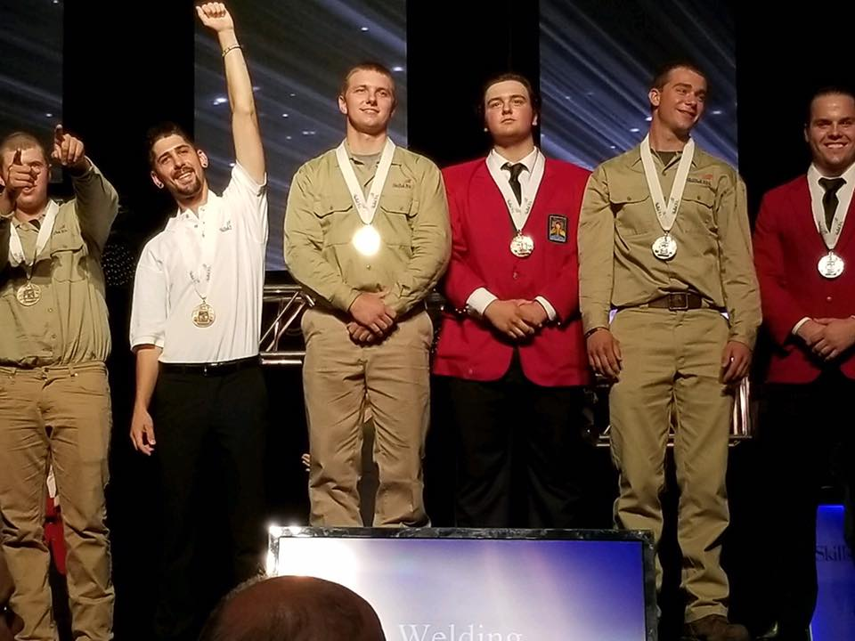 Cedartown, Georgia's Ryan Fincher becomes Georgia Northwestern Technical College's first-ever national champion in the 2017 SkillsUSA competition in Louisville, Kentucky. Fincher, shown third from the left, poses alongside his other Top-10 finishers on the medal stage in Louisville, Kentucky. Fincher is a three-time Georgia SkillsUSA champion, twice on the high school level and once on the collegiate level.